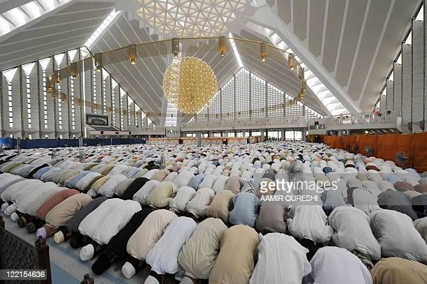 Pakistani Muslims offer JummatulVida last Fridayprayers during the holy month of Ramadan at the grand Faisal Mosque in Islamabad on August 26 2011...