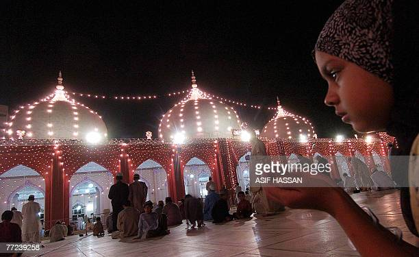 Pakistani Muslims offer prayers at a mosque in Karachi 09 October 2007 on the occasion of the Laylat AlQadr Festival Laylat alQadr is the anniversary...