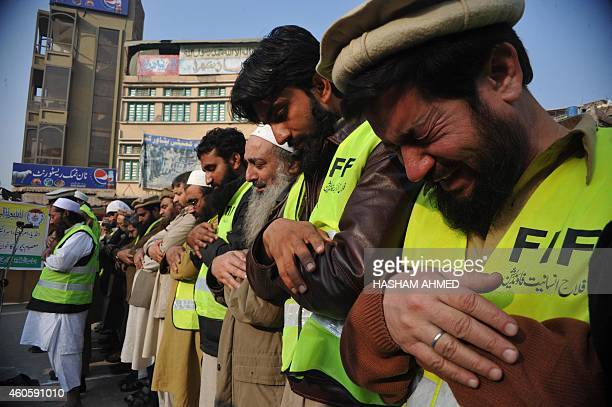 Pakistani Muslims offer prayers during a funeral ceremony a day after an attack on an armyrun school by Taliban militants in Peshawar on December 17...