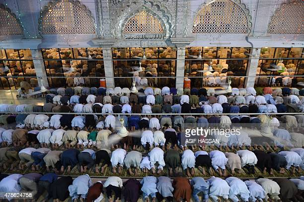 Pakistani Muslims offer special prayers at a mosque to mark ShabeBarat or the night of forgiveness in Karachi on June 2 2015 Muslims believe that if...
