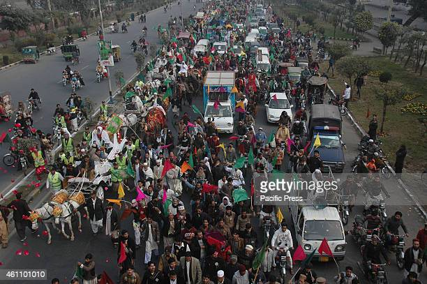 Pakistani Muslims participate in a rally celebrating the birthday of Prophet Mohammed . The birthday of Prophet Mohammed , is also known as 'Milad',...