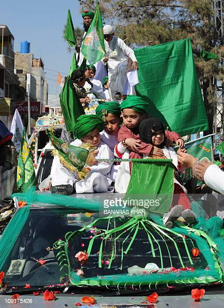 Pakistani Muslims participate in a religious procession to celebrate EideMiladunNabi the birthday of Prophet Mohammed in Quetta on February 16 2011...
