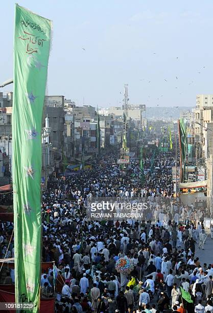 Pakistani Muslims participate in a religious procession to celebrate EideMiladunNabi the birthday of Prophet Mohammed in Karachi on February 16 2011...