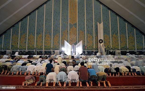 Pakistani Muslims perform a special 'Taraweeh' evening prayer on the first day of the Muslim fasting month of Ramadan at the grand Faisal Mosque in...