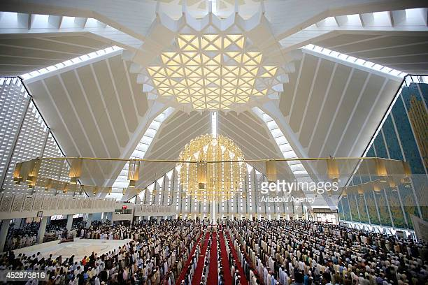 Pakistani muslims perform Eid alFitr prayer at Faisal Mosque in Islamabad Pakistan on July 29 2014