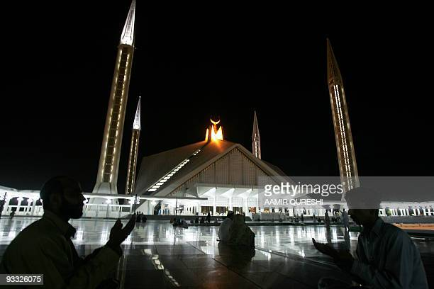 Pakistani Muslims pray during a special night prayer at the Faisal Mosque to mark ShabeBarat or night of forgiveness in Islamabad 28 August 2007...