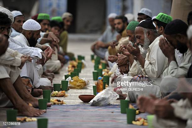 Pakistani Muslims pray prior to breaking their fast at a mosque in Rawalpindi on August 17 on the 16th day of Muslim fasting month of Ramadan Ramadan...