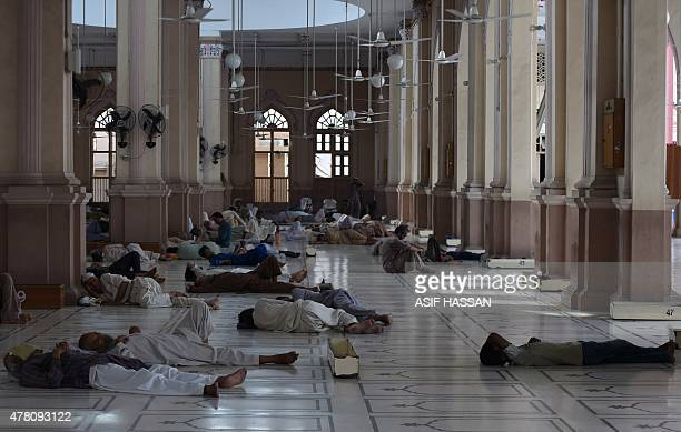 Pakistani Muslims rest at a mosque during a heatwave in Karachi on June 22 2015 Nearly 200 people have died in a heatwave in southern Pakistan...