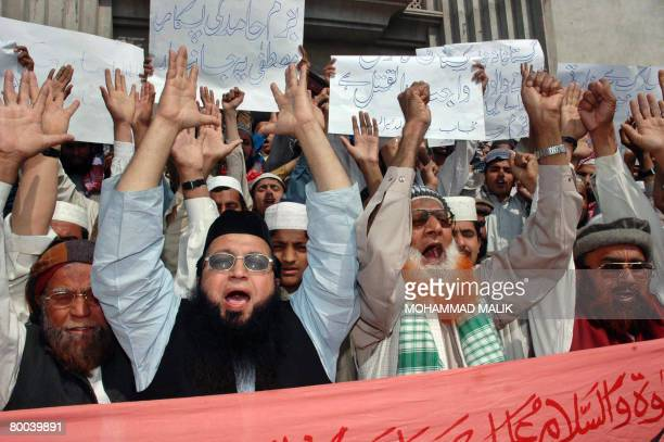 Pakistani Muslims shout antiDanish slogans during a protest against the publication of drawings depicting the Prophet Mohammad in Multan on February...