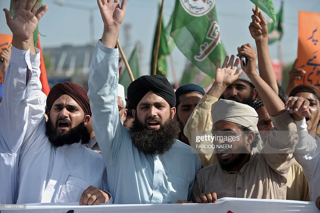 Pakistani Muslims shout slogans during a protest in Rawalpindi on May 21, 2010. Pakistani protesters shouted 'Death to Facebook', 'Death to America' and burnt US flags, venting growing anger over 'sacrilegious' caricatures of the Prophet Mohammed on the Internet. AFP PHOTO/Farooq NAEEM