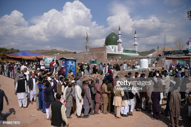 Pakistani Muslims stand in a queue to visit the tomb of Mumtaz Qadri who was hanged in February 2016 for the murder of a governor who criticized...