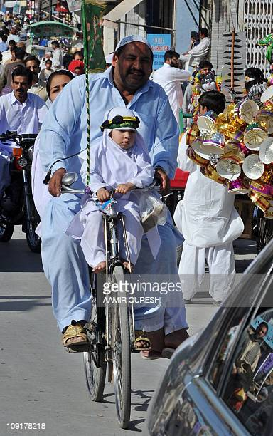 Pakistani Muslims take part in a religious procession during celebrations marking EideMiladunNabi the birth of Islam's Prophet Mohammed in Rawalpindi...