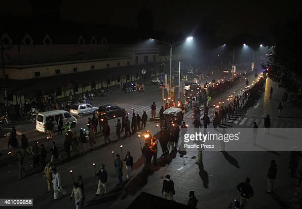 Pakistani Muslims take torch parade during the birthday celebration of Prophet Mohammed in Lahore. The birthday of Prophet Mohammed, also known as '...