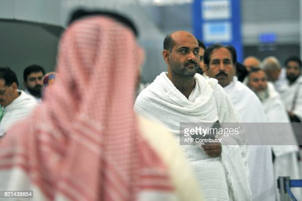 Pakistani Muslims wait to be checked by security as the first pilgrims for the annual Hajj pilgrimage arrive in Jeddah on July 24 2017 PHOTO / Amer...