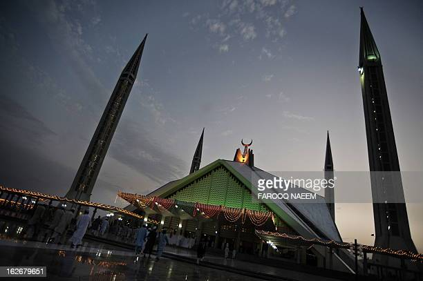 Pakistani Muslims walk at the Faisal Mosque in Islamabad on September 6 on the ShabeQadr the 27th night of the Holy month of Ramadan in which...