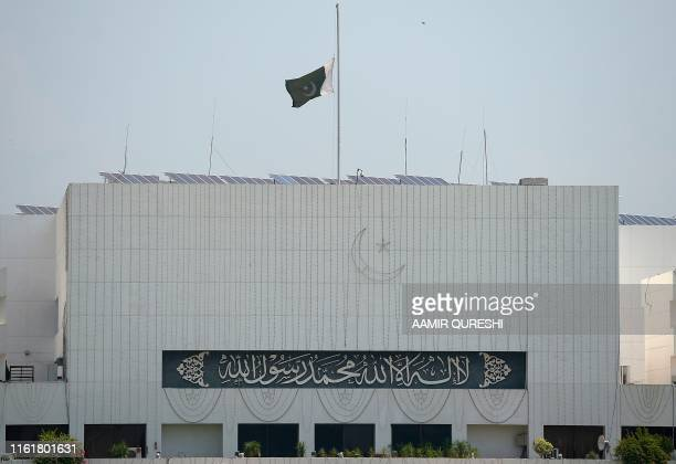 A Pakistani national flag flies at halfmast on the Parliament building in Islamabad on August 15 as the country observes 'Black Day' on India's...