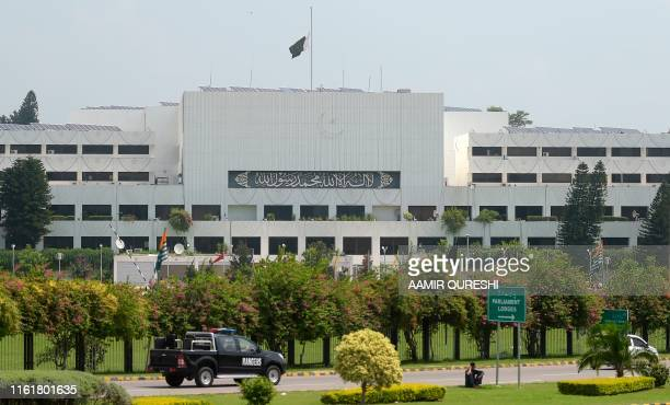 Pakistani national flag flies at half-mast on the Parliament building in Islamabad on August 15 as the country observes 'Black Day' on India's...