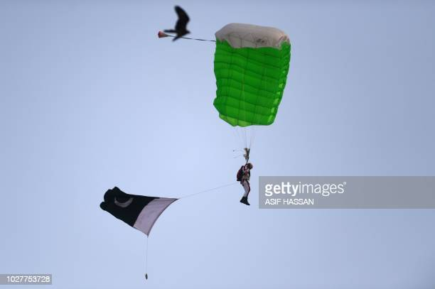 A Pakistani naval paratrooper performs during celebrations to mark Defence Day at Clifton Beach in Karachi on September 6 2018 Pakistan on September...