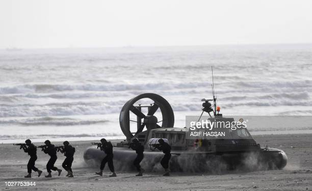 Pakistani naval soldiers take part in a drill during celebrations to mark Defence Day at Clifton Beach in Karachi on September 6 2018 Pakistan on...