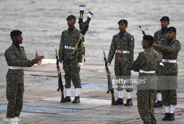 Pakistani naval soldiers take part in celebrations to mark Defence Day at Clifton Beach in Karachi on September 6 2018 Pakistan on September 6...