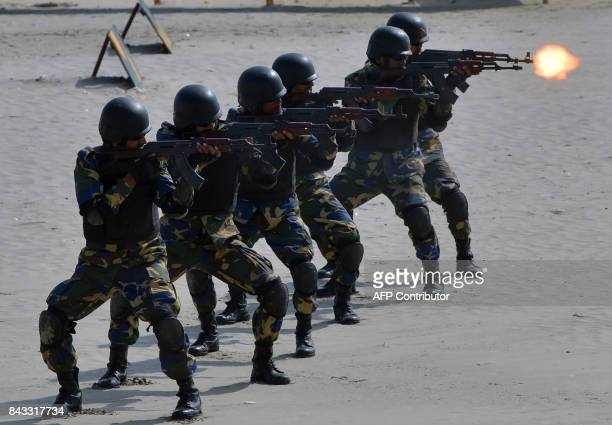 TOPSHOT Pakistani Naval soldiers take part in celebrations to mark Defence Day at Clifton beach in Karachi on September 6 2017 Pakistan on September...