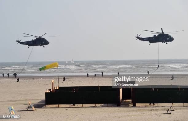 Pakistani Navy helicopters and soldiers take part in celebrations to mark Defence Day at Clifton beach in Karachi on September 6 2017 Pakistan on...