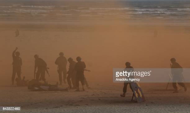 Pakistani Navy soldiers take part in a drill on a beach during celebrations to mark the 52nd anniversary of Defence Day in Karachi Pakistan on...