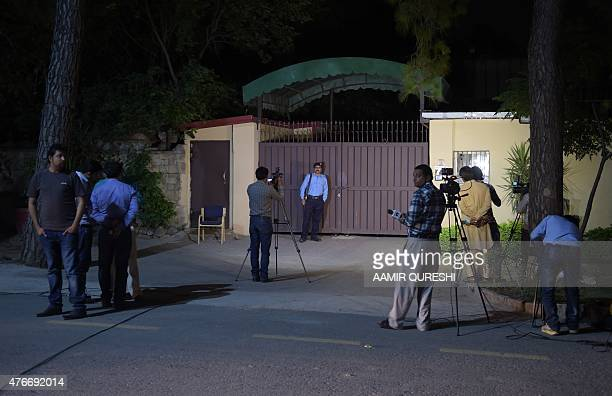 Pakistani news cameramen take footage of the office of the international charity 'Save the Children' sealed by order of Pakistani authorities in...