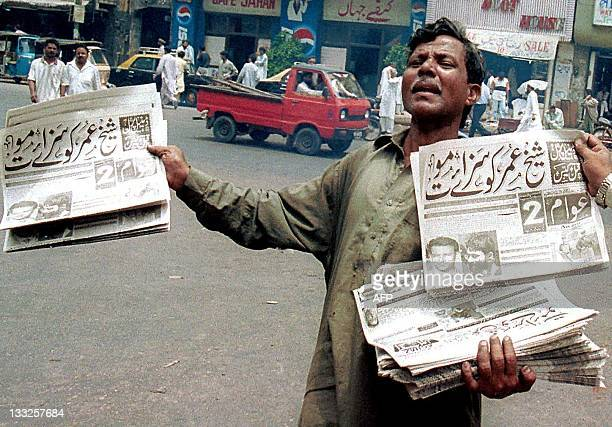 Pakistani newspaper vendor sells evening newspapers carrying front page news of the verdict in the US journalist Daniel Pearl murder trial in...