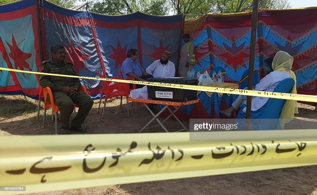 Pakistani officials wait to exhume the grave of Italian national of Pakistani origin Sana Cheema who was allegedly killed by her family members in...