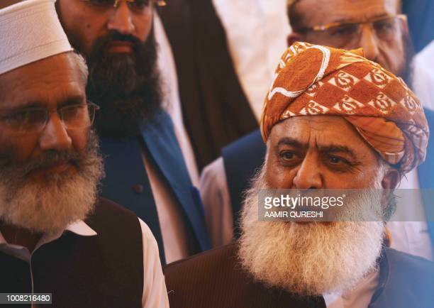 Pakistani opposition leader and head of Muttahida MajliseAmal a religious parties alliance Maulana Fazalur Rehman speaks to media after attending a...