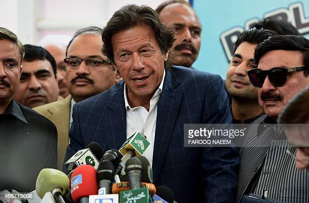 Pakistani opposition leader and head of the TehreekiInsaf political party Imran Khan talks to media following after the start of a special...