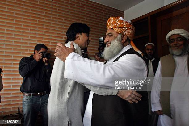 Pakistani opposition leader Maulana FazalurRehman greets Chaudhry Nisar before a meeting to discuss the reopening of NATO supply lines to Afghanistan...