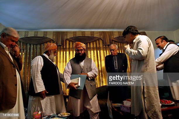 Pakistani opposition leaders Aftab Sherpao Maulana FazalurRehman Mulana Gafur Hadri Chaudhry Nisar arrive at a meeting to discuss the reopening of...