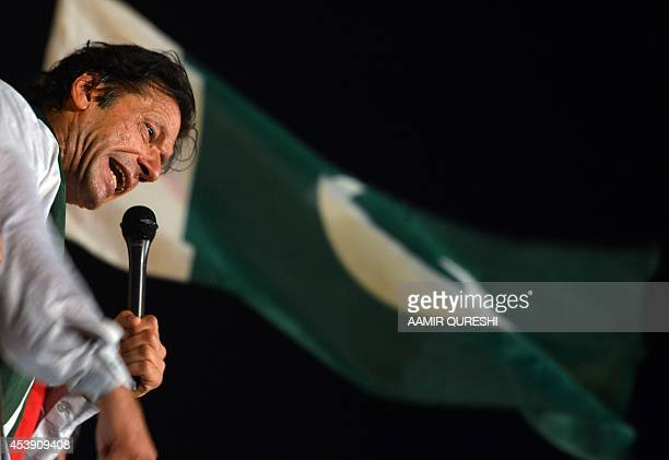Pakistani opposition politician Imran Khan addresses his supporters during an antigovernment protest in front of the Parliament building in Islamabad...