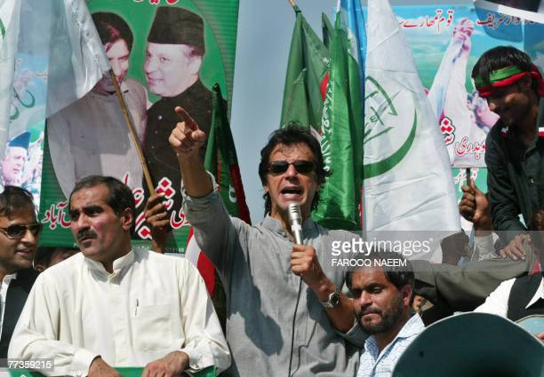 Pakistani opposition politician Imran Khan addresses the gathering of opposition parties activists outside the Supreme Court building in Islamabad 17...