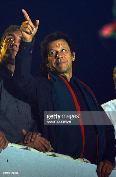 Pakistani opposition politician Imran Khan gestures during a protest march against the country's Pakistan Muslim LeagueNawazled government in...