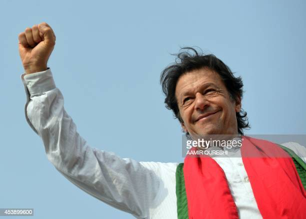 Pakistani opposition politician Imran Khan gestures to supporters during an antigovernment protest in Islamabad on August 21 2014 Pakistani...
