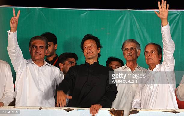 Pakistani opposition politician Imran Khan stands onstage alongside senior party leaders during an antigovernment protest in front of the Parliament...
