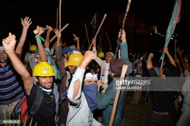 Pakistani opposition protesters shout antigovernment slogans as they try to move toward the Prime Minister's residence following clashes with...