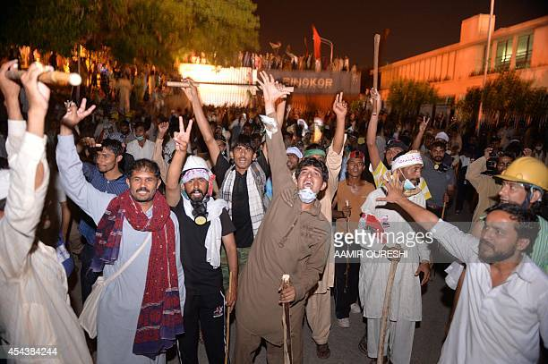 Pakistani opposition protesters shout slogans as they march towards the prime minister's residence in Islamabad on August 30 2014 Police in...