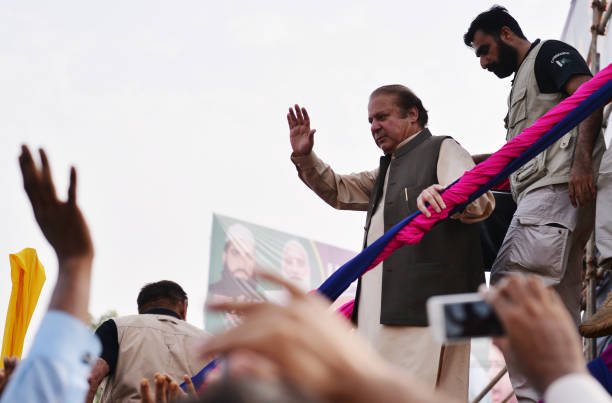 Pakistani ousted prime minister Nawaz Sharif waves to supporters as he leaves the stage during a rally in Gujrat city in Punjab province on August 11.