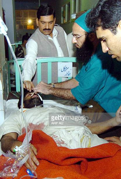 Pakistani paramedic treats a man who was injured by a bullet during the Basant festival at a hospital in Lahore 06 February 2005 Thirteen people have...