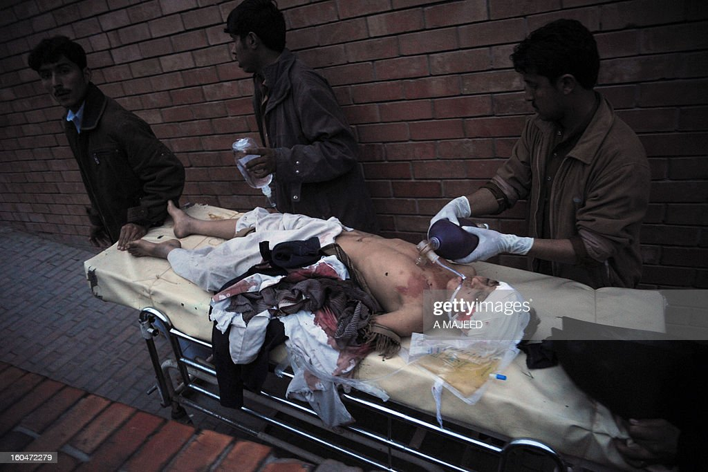 Pakistani paramedics tend to an injured bomb blast victim at a hospital in Peshawar on February 1, 2013, after an explosion outside a Shiite Muslim mosque in Hangu. A suicide bomber targeted a Shiite Muslim mosque in northwest Pakistan on Friday, killing 21 people and wounding up to 50 as worshippers poured out of weekly prayers, officials said.