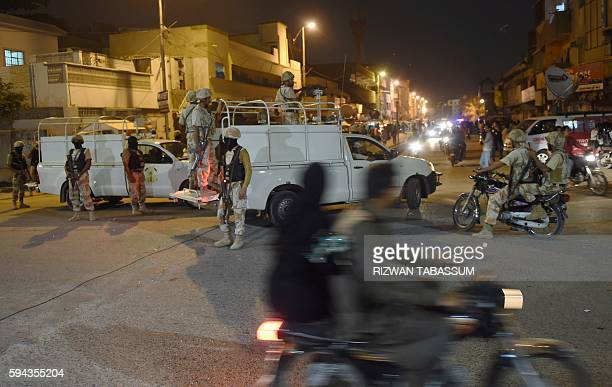 Pakistani paramilitary rangers cordon off a street leading to the headquarters of the Muttahida Qaumi Movement political party after it was sealed by...