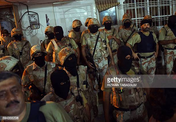 Pakistani paramilitary rangers cordon off the headquarters of the Muttahida Qaumi Movement political party after it was sealed by paramilitary...