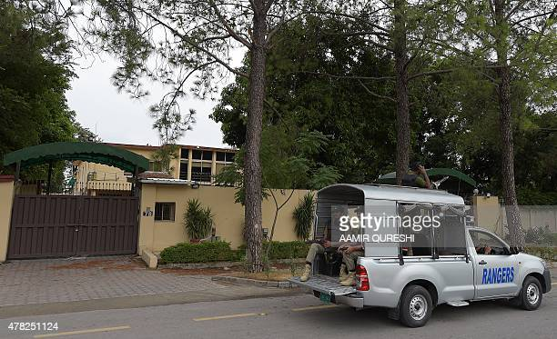 Pakistani paramilitary rangers patrol outside the main office of international charity 'Save the Children' in Islamabad on June 24 2015 Save the...
