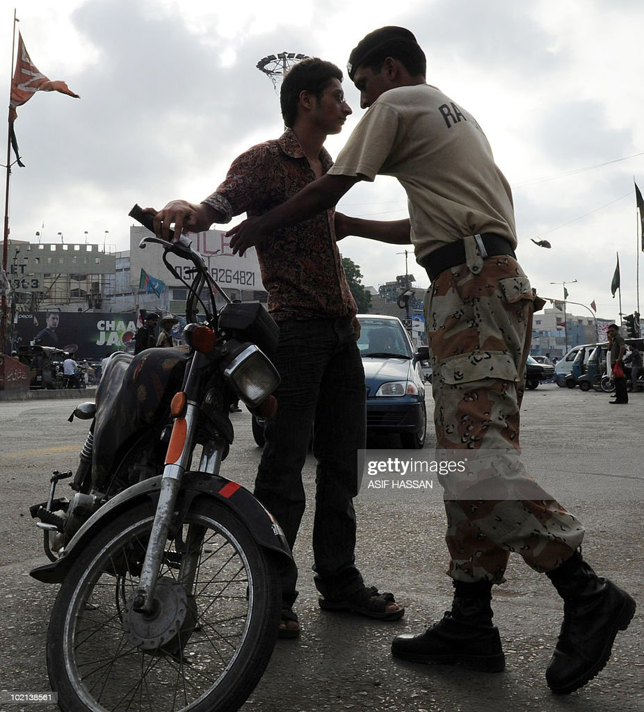 A Pakistani paramilitary soldier frisks a biker on a street in Karachi on June 16, 2010. Pakistan has banned public political meetings in its largest city of Karachi in an effort to control a renewed wave of targeting killings, a senior government official said.
