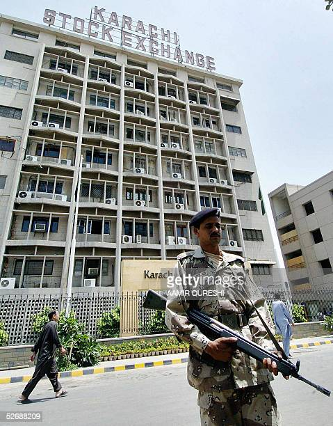 Pakistani paramilitary soldier guards the Karachi Stock Exchange building in Karachi 23 April 2005 Last month the KSE shed a third of its value in...