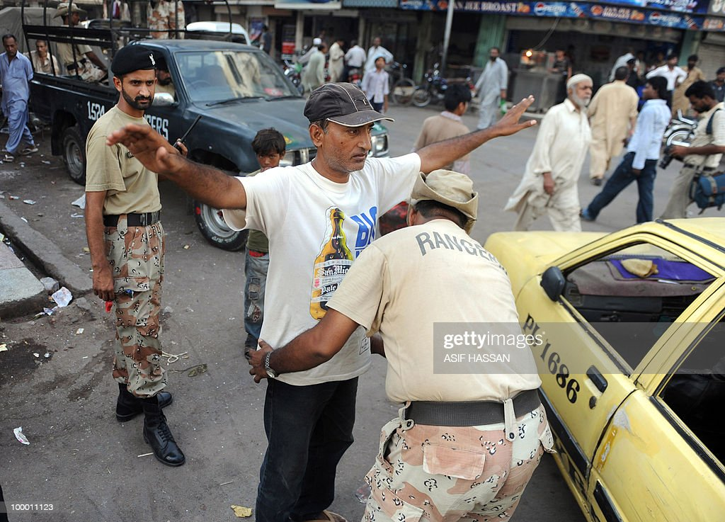 A Pakistani paramilitary soldier searches a commuter on a street in Karachi on May 20, 2010. At least 17 people including two children have been killed in political clashes in Pakistan's financial capital Karachi in the past two days, a government official and police said. Police and paramilitary have been put on high alert and authorities closed all schools and colleges after the latest outbreak of politically related violence in Karachi, the biggest and richest city in Pakistan.